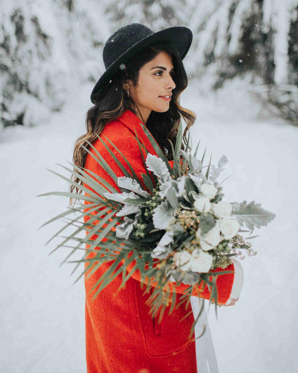 winter wedding guest attire woman in blood orange coat