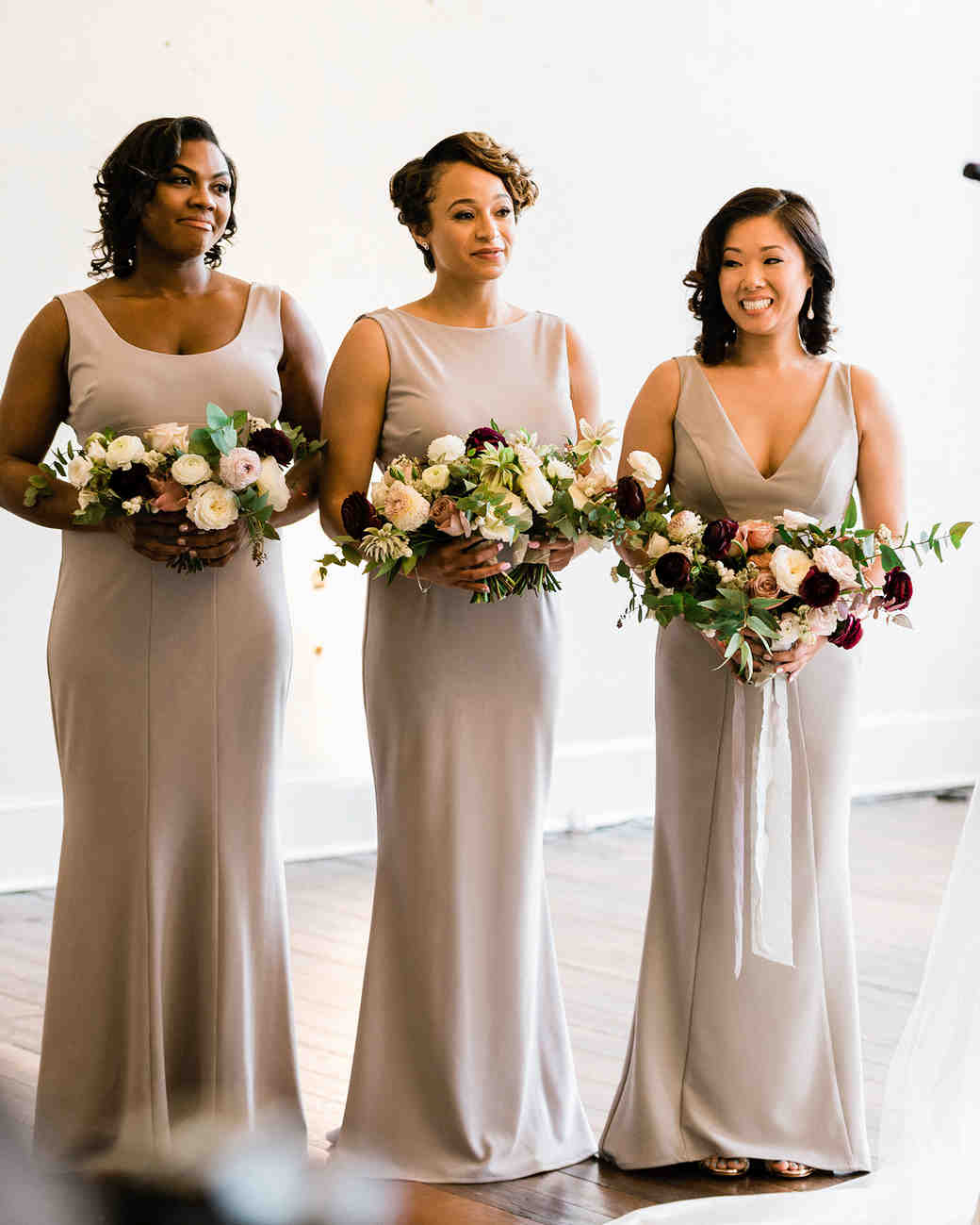bridesmaids and maid of honor with ribbon bouquet