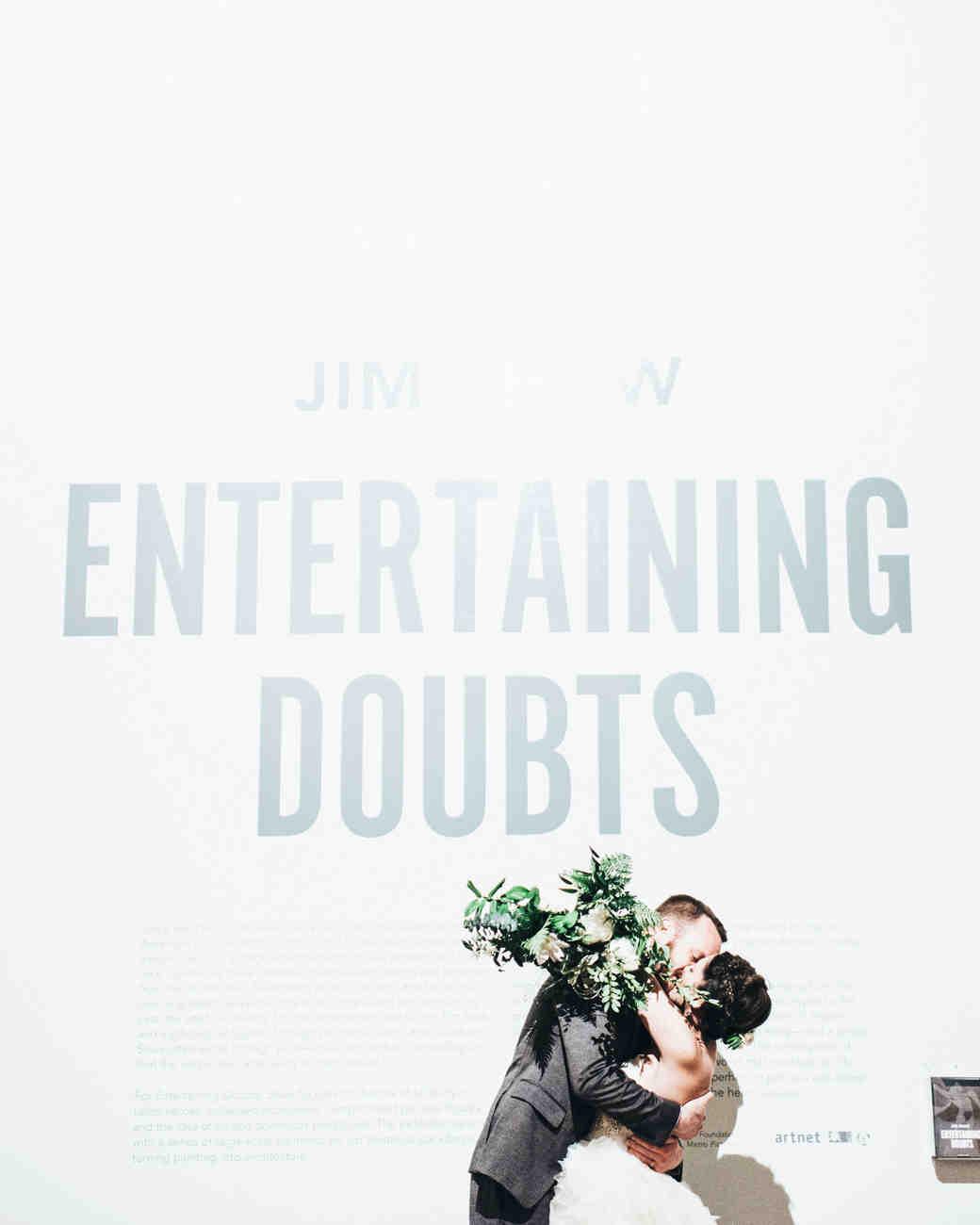moira-dustin-wedding-cocktail-couple-hug-museum-322-s112717.jpg