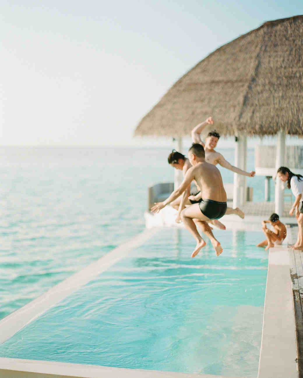 kids jumping in a pool