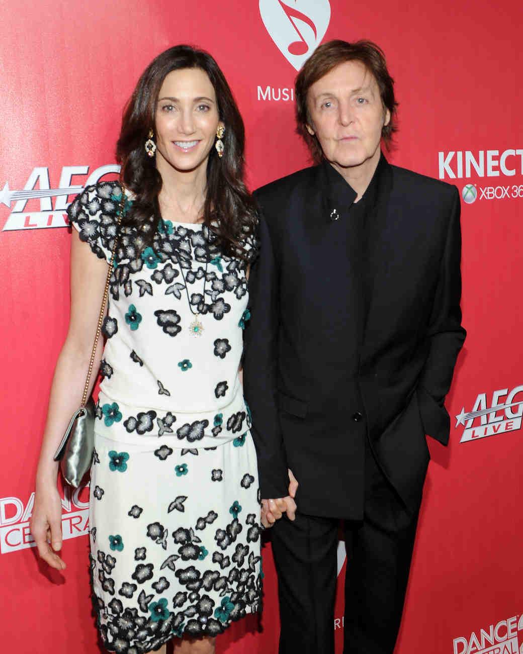 celebrity couple paul nancy black suit white floral dress