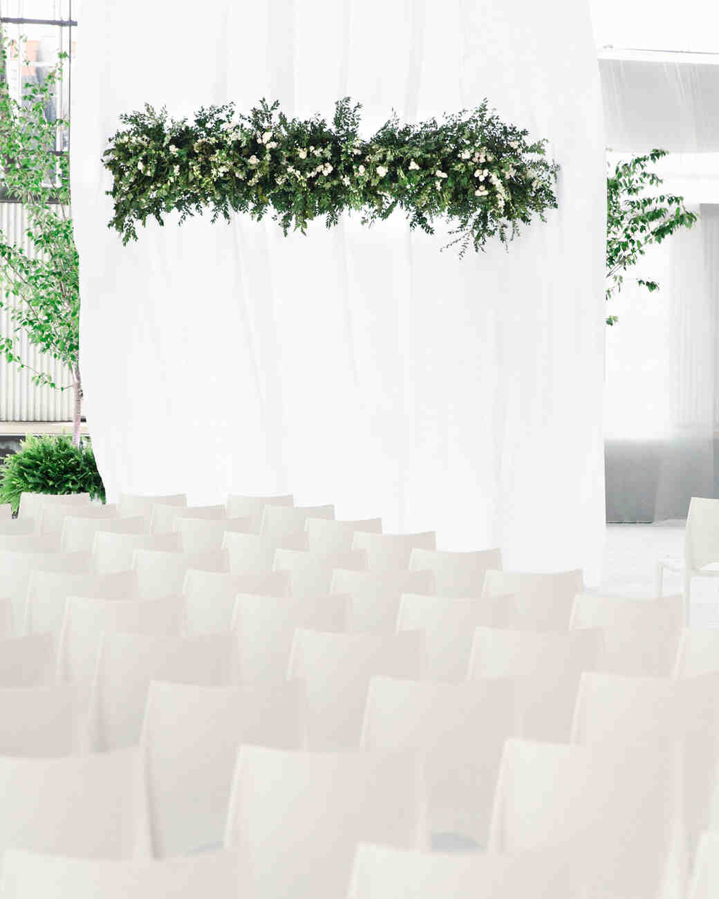 modern ceremony space with greenery chandelier