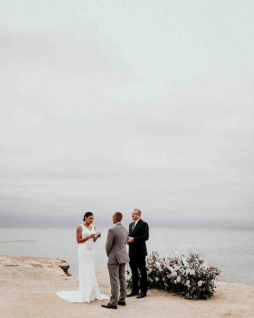 wedding ground floral small arch beach front