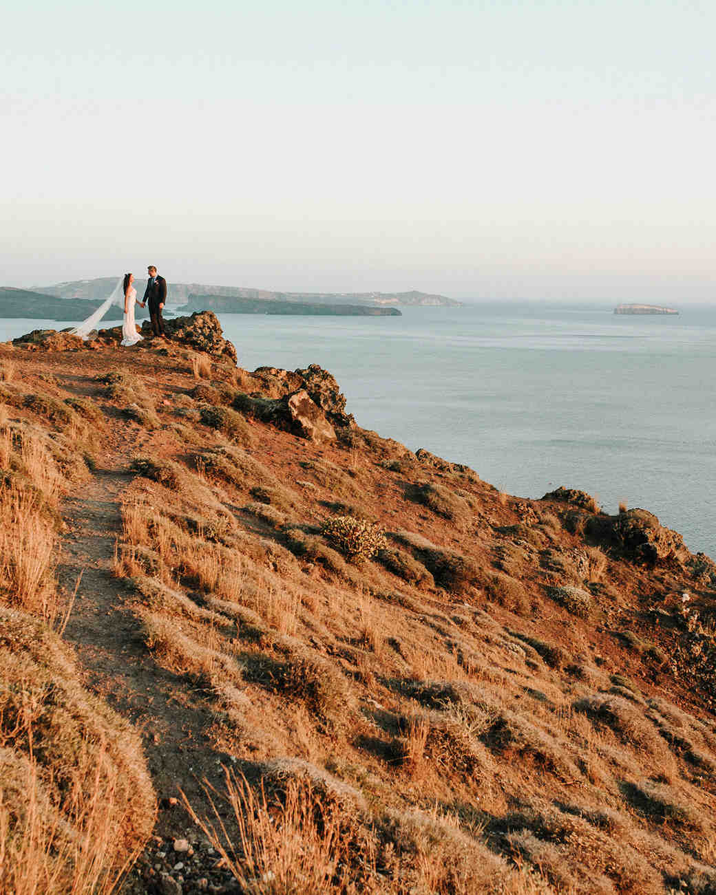 couple on hillside in santorini