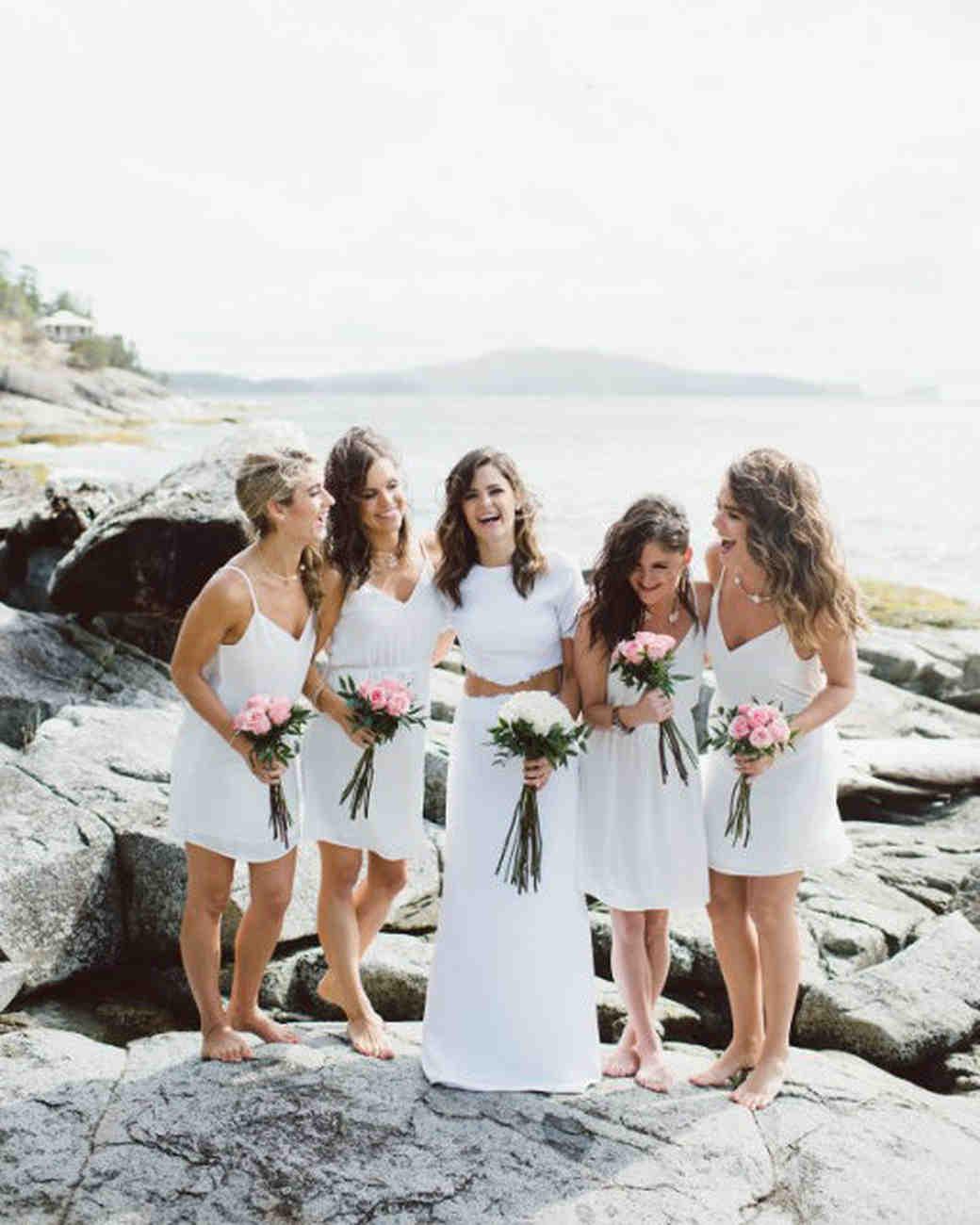 bride bridesmaids on beach