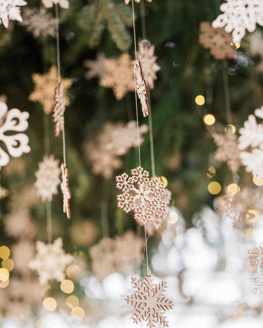 hanging wooden snowflakes and lights over dance floor