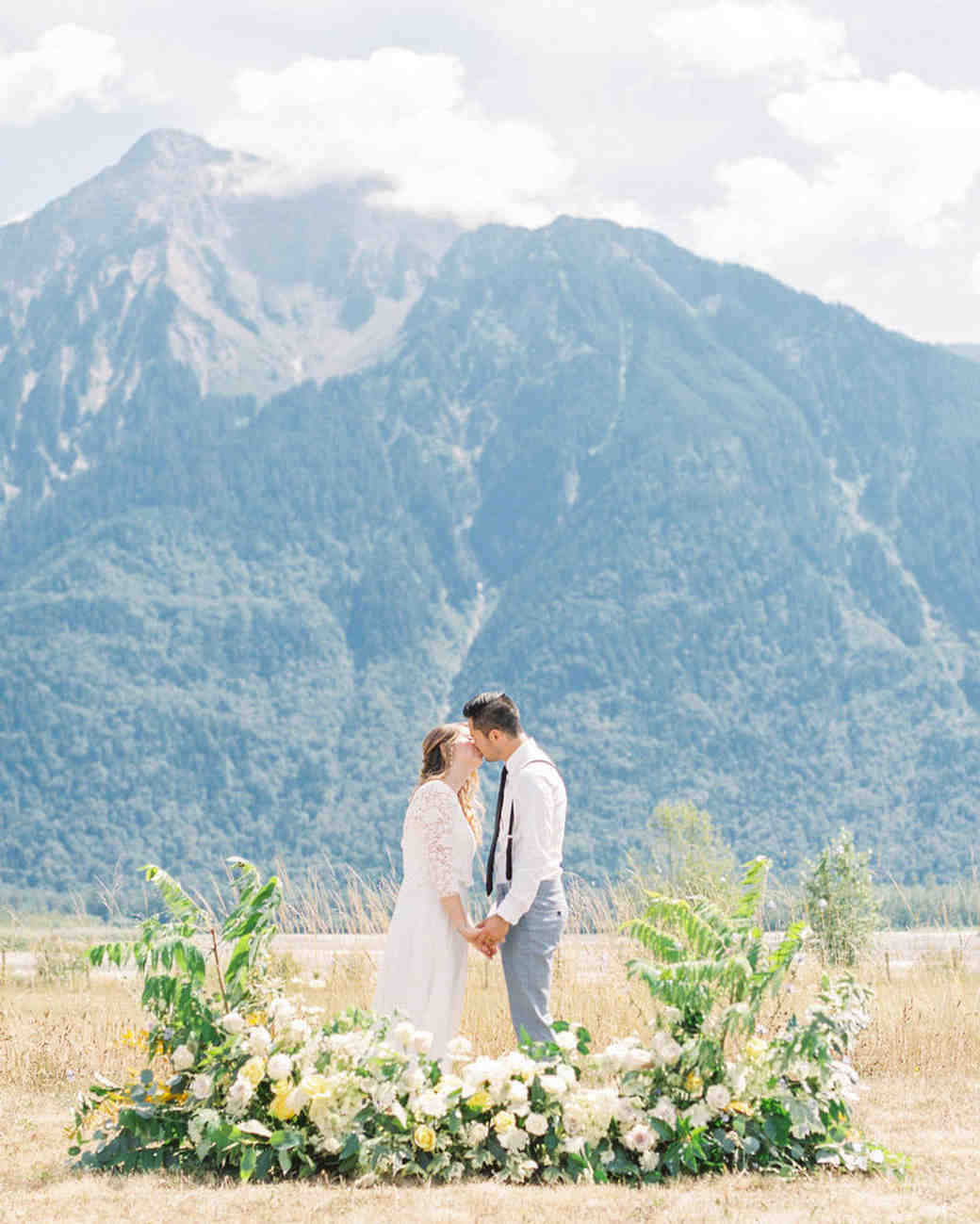 wedding ground floral arches wild over grown mountain view