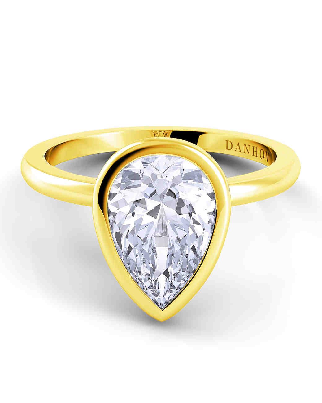 Danhov bezel set yellow gold engagement ring pear-cut diamond