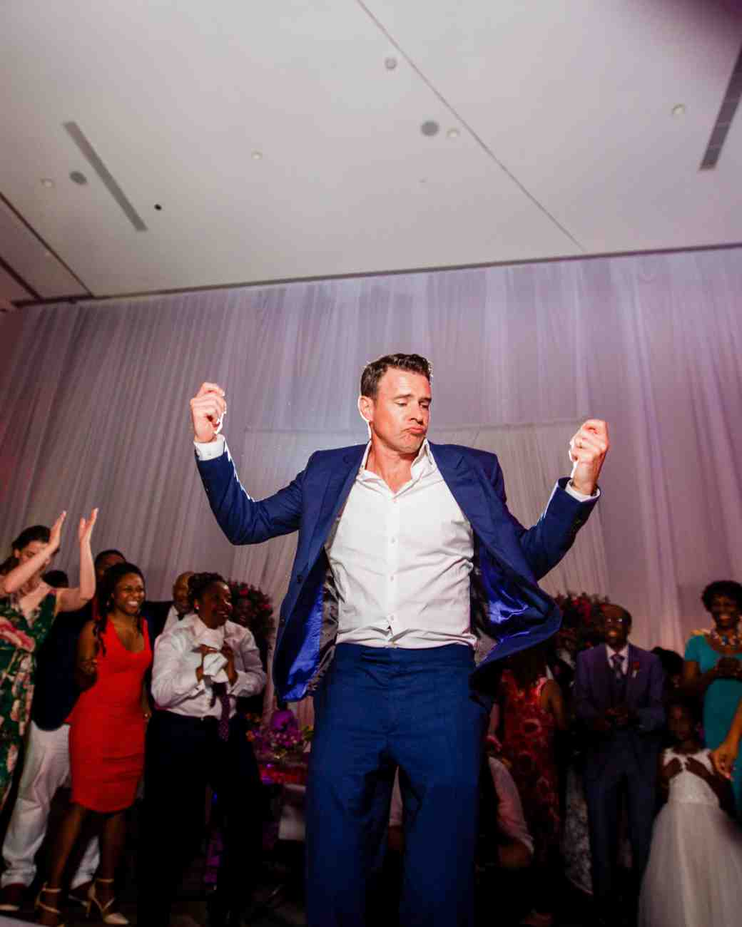 wedding reception man in blue suit dancing