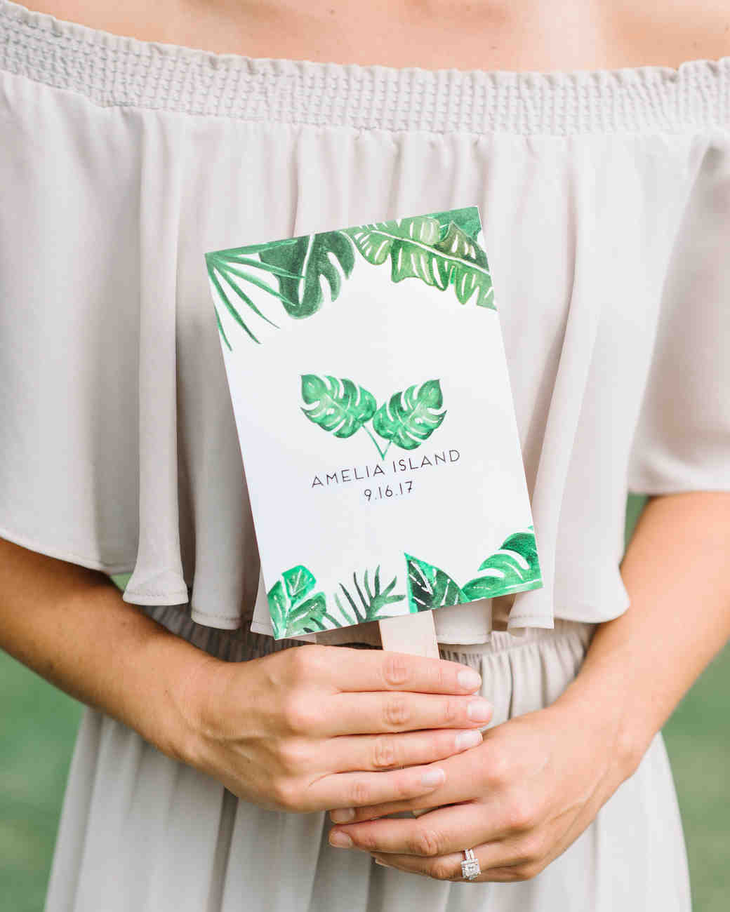 ceremony program fan with tropical leaves