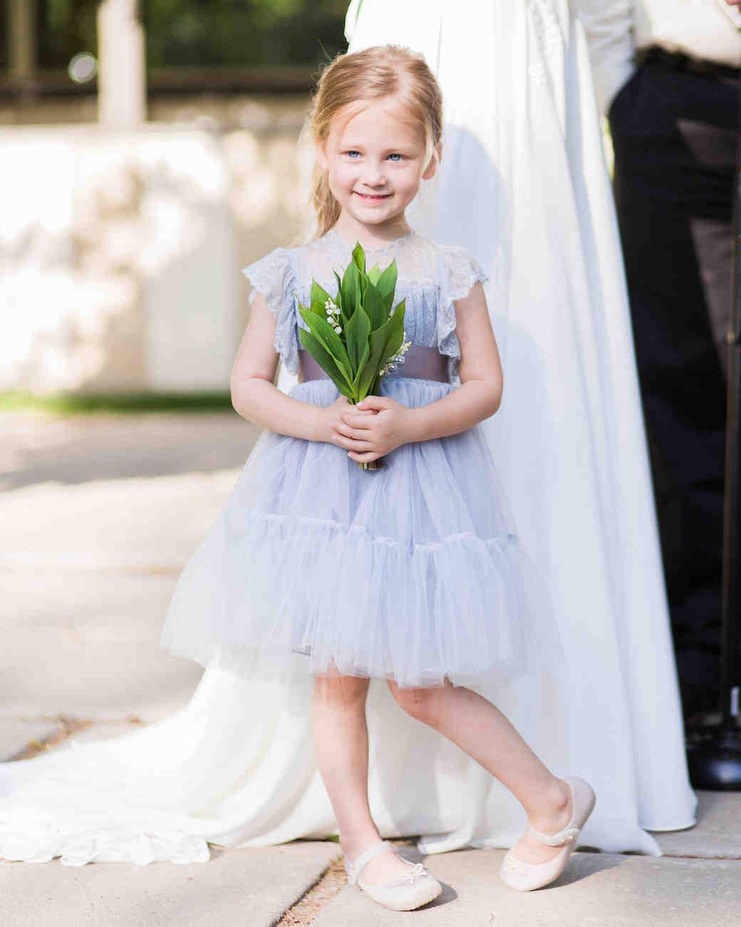 flower girl wearing light blue dress