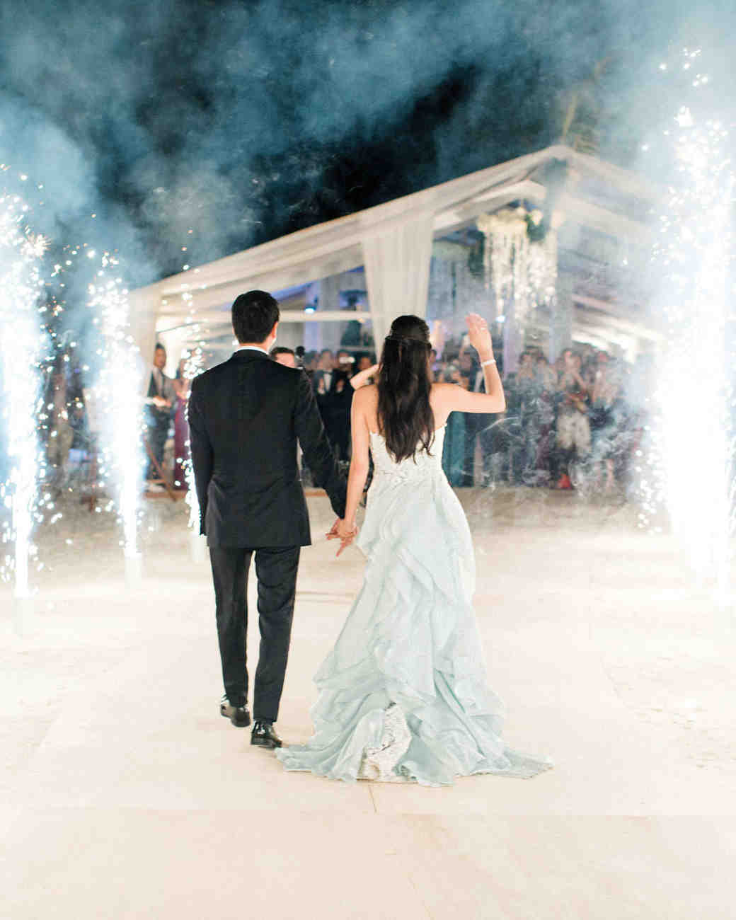 couple walking through shooting sparklers