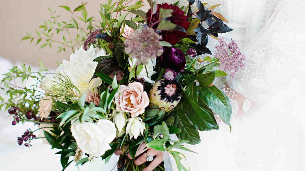 britt courtney wedding minnesota purple fall bouquet