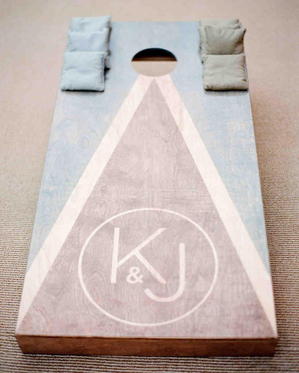 kelsey joc wedding santa barbara california monogram cornhole