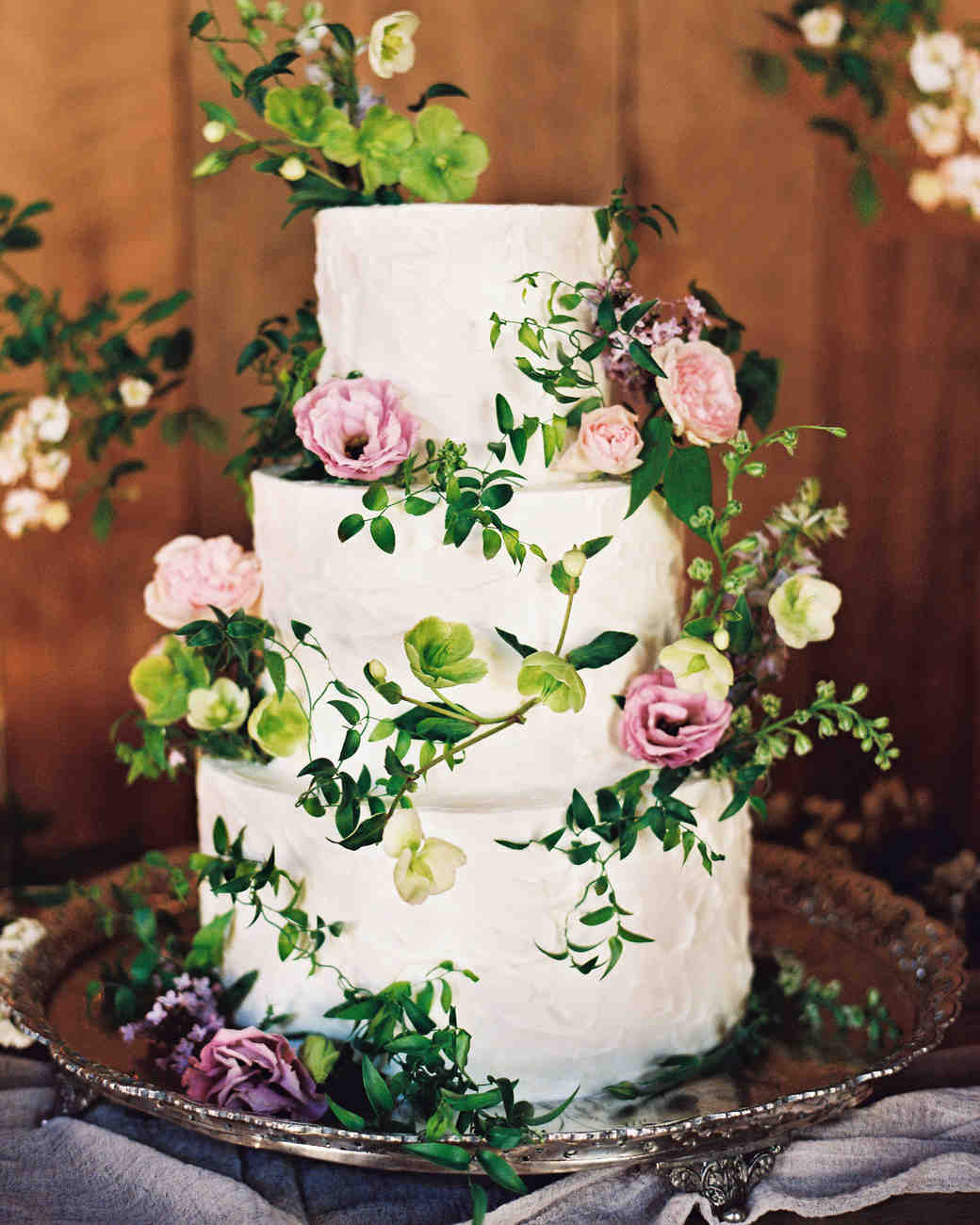 White Buttercream Wedding Cake with Pink Flowers and Green Vines