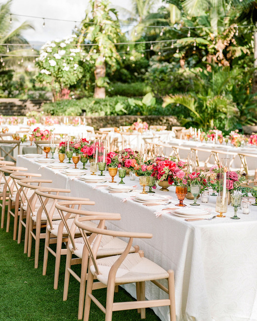 cream colored linens and floral centerpiece reception table displays