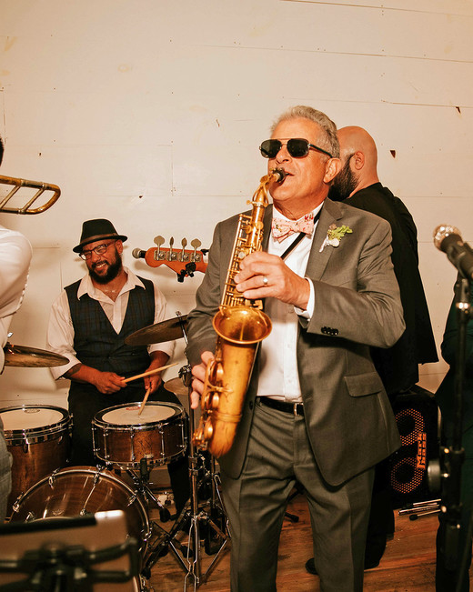 rose chris wedding band saxophone player