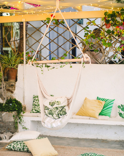 Seaside Hammock with palm leaf-printed pillows