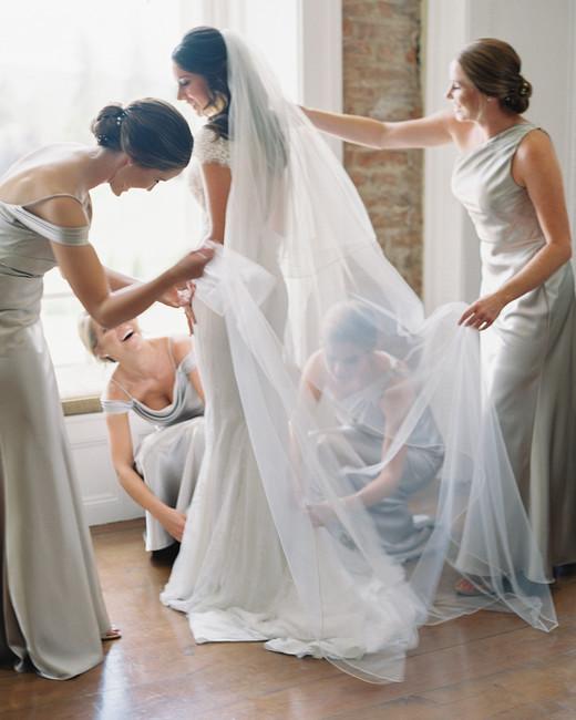 bride wearing low back tulle bow Lihi Hod wedding dress