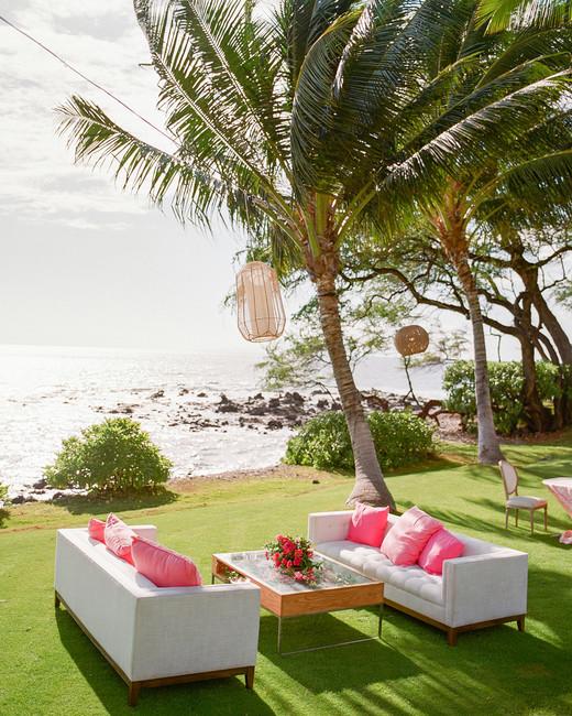 lounge area with rattan furniture, Koa wood coffee table, and bamboo pendant lighting