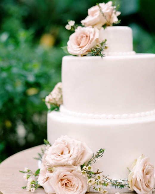 three-tier white wedding cake decorated flowers