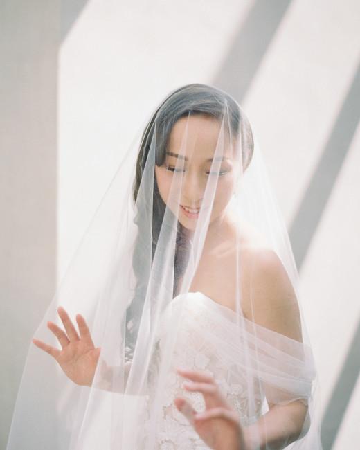 bride wearing a sara gabriel wedding veil