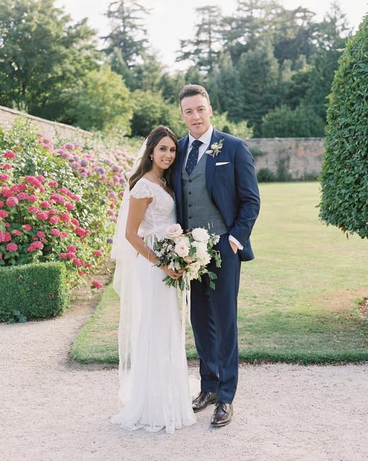 bride and groom pose for portrait in garden venue