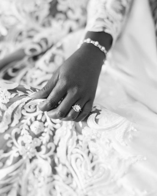 bride wearing flower shaped wedding ring