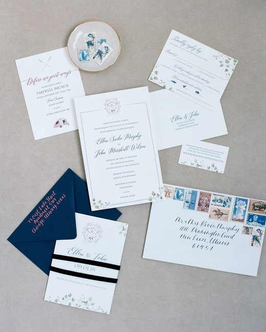 navy and with invitation suit with personalized wedding crest