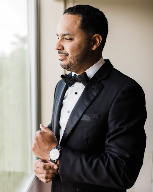 groom wearing traditional black tuxedo wedding look