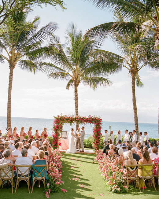 bride and groom at outdoor wedding alter overlooking west maui ocean and mountains