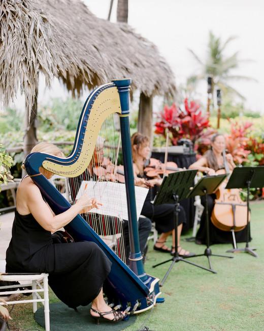 string quartet playing at Four Seasons Lumeria Garden