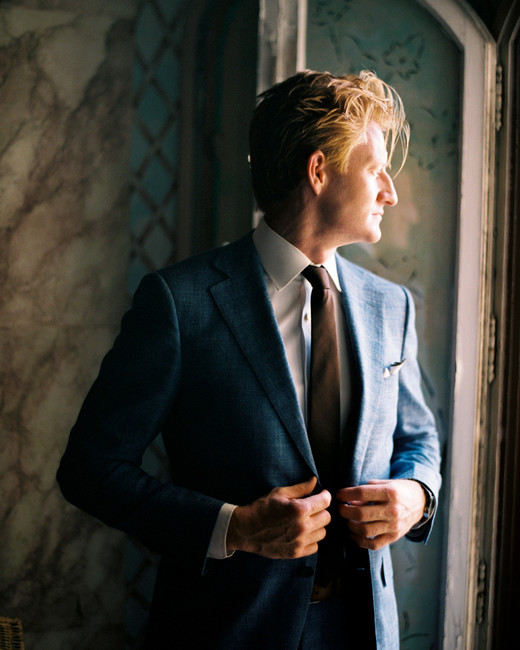 groom wearing blue wedding suit