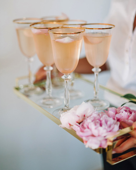 glasses of rose with floating petalsa