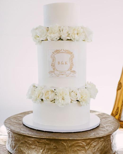 white monogrammed wedding cake with roses