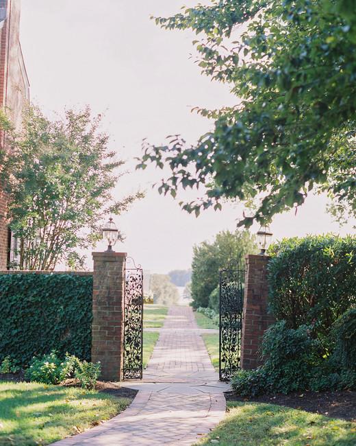 outdoor wedding venue gated entryway brick walkway