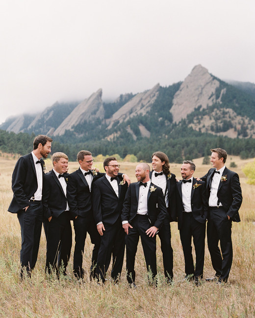 groom with groomsmen outside with mountain in background