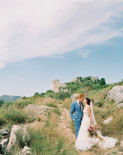 bride and groom stand on hillside south of france venue
