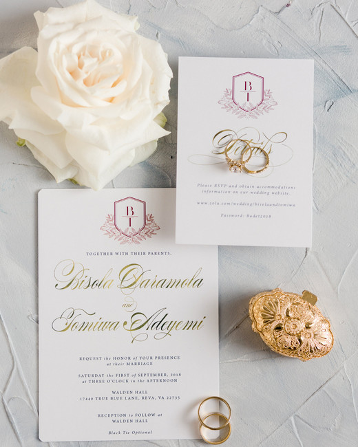 red monogram with gold leaf calligraphy on white stationary