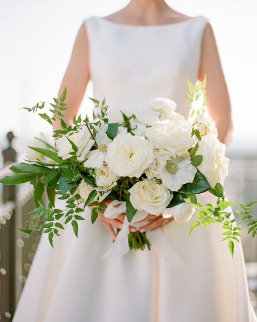 white garden roses, ranunculus, tulips, anemones and green bay leaves, vines, and gardenia foliage wedding bouquet