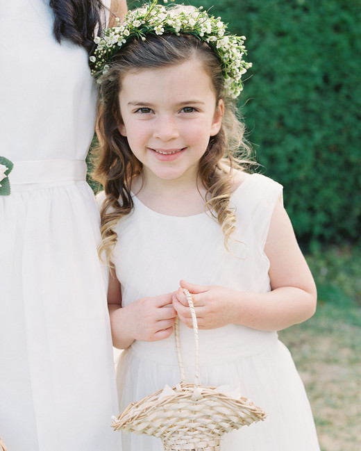 flower girl wearing white dress and flower crown