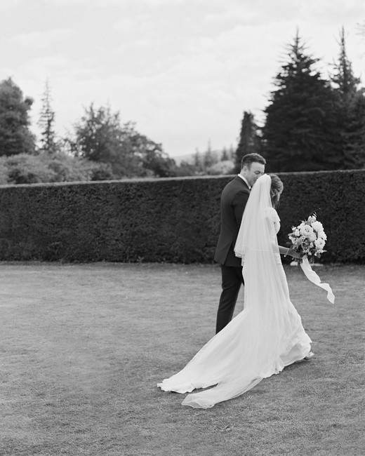 bride and groom walking away after recessional