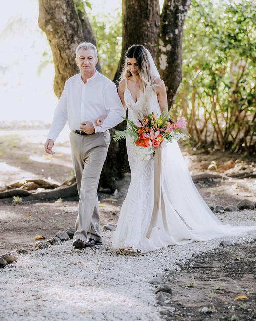 father of the bride walking bride down outdoor costa rican wedding venue aisle