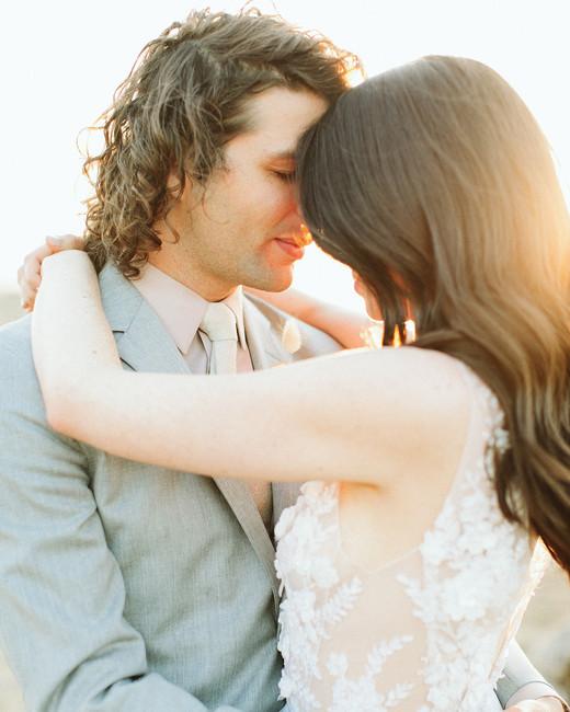 ashley basil wedding couple embrace golden hour