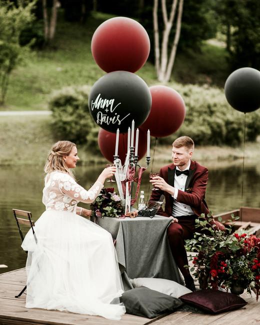 dark red and black wedding balloon decor wedding color scheme