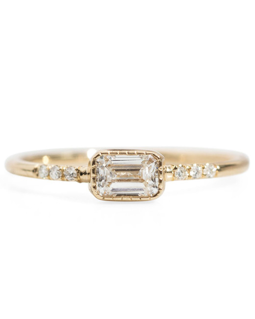 emerald cut ring gold band with diamonds on either side