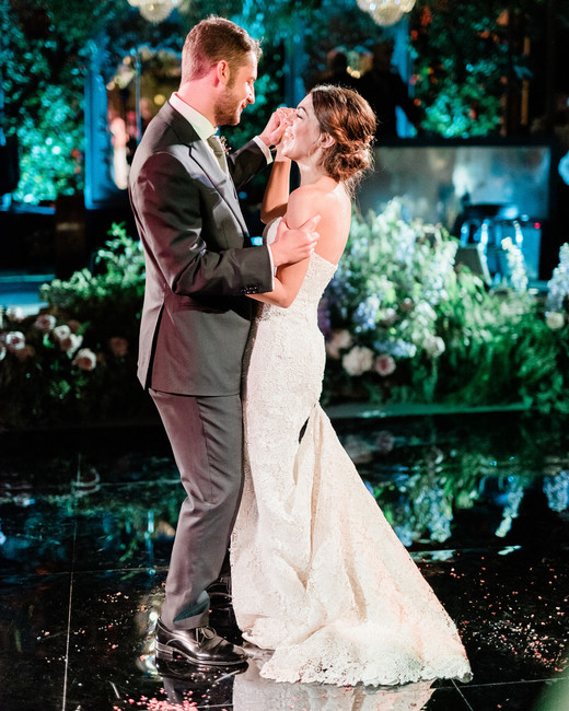 bride and groom on dance floor during first dance