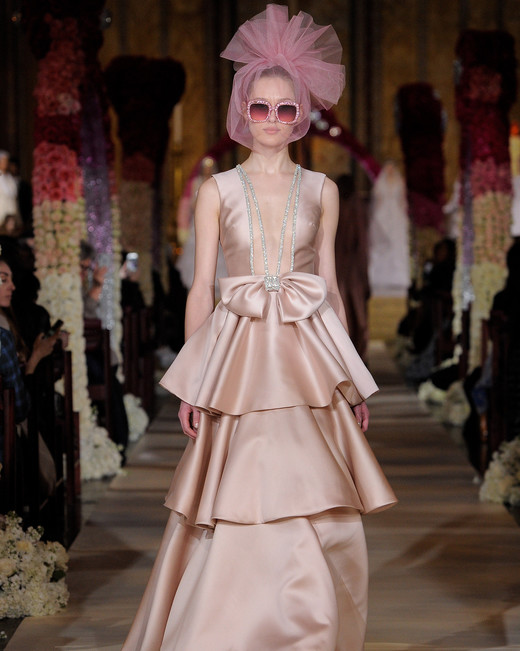dusty rose colored bow front tiered wedding dress Reem Acra Spring 2020