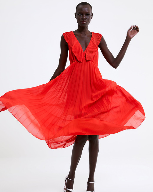 red sleeveless pleated dress
