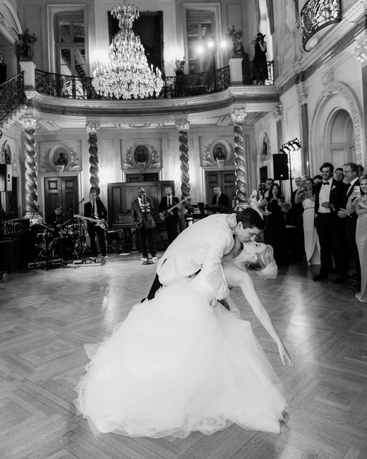 groom dips bride during reception on dance floor
